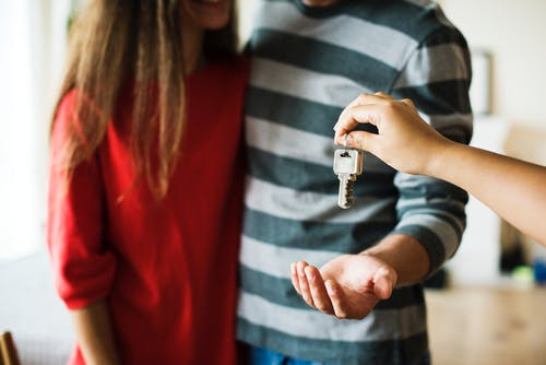 Handing a couple a set of keys